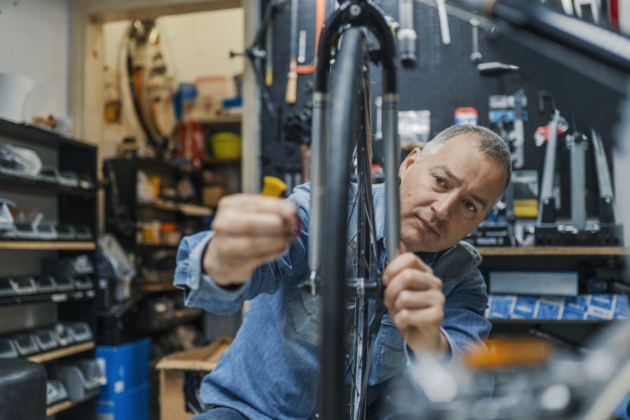 Man working in a bike repair shop